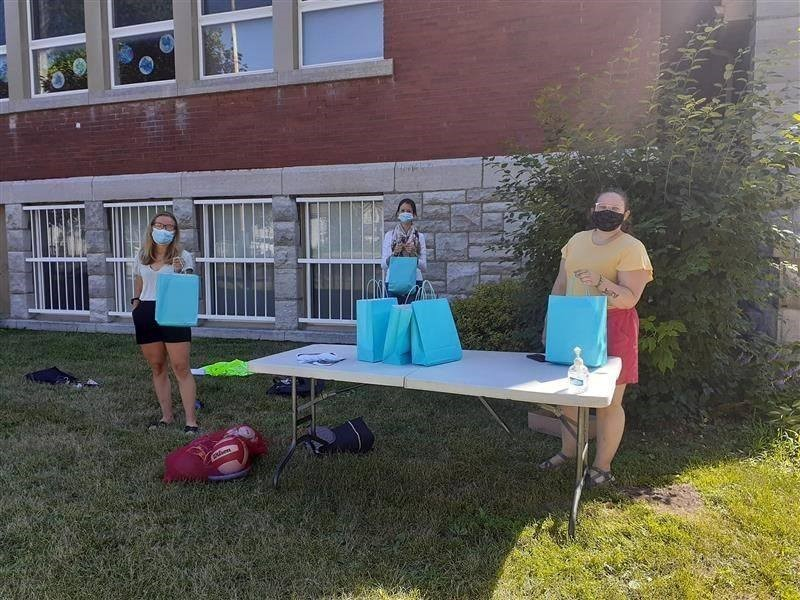 Members of the Youth Diversion team hand out free summer activity kits in central Kingston last summer.